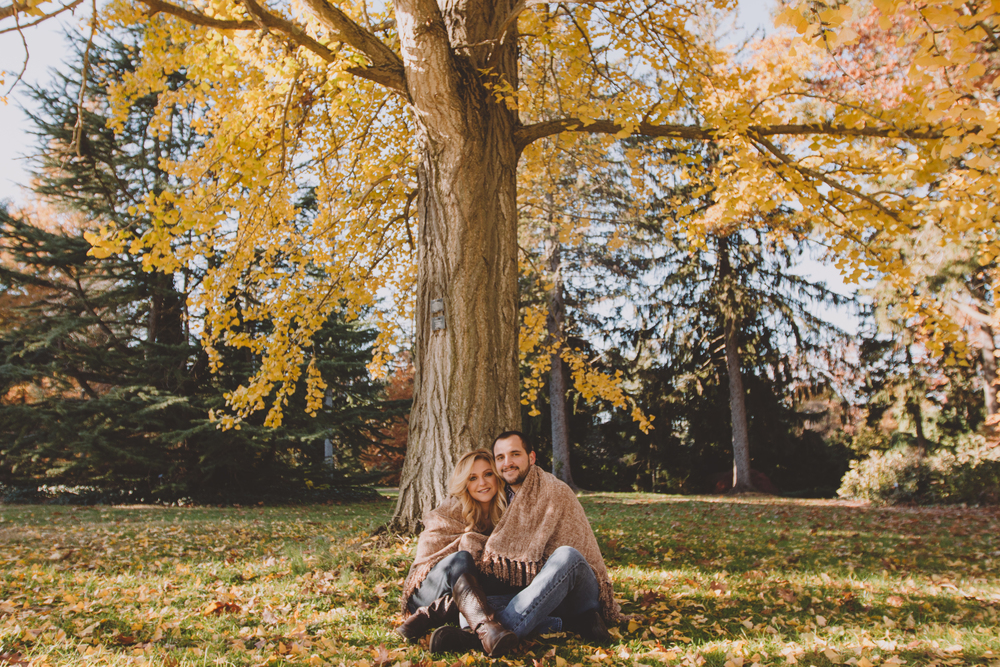blanket prop in engagement session during fall