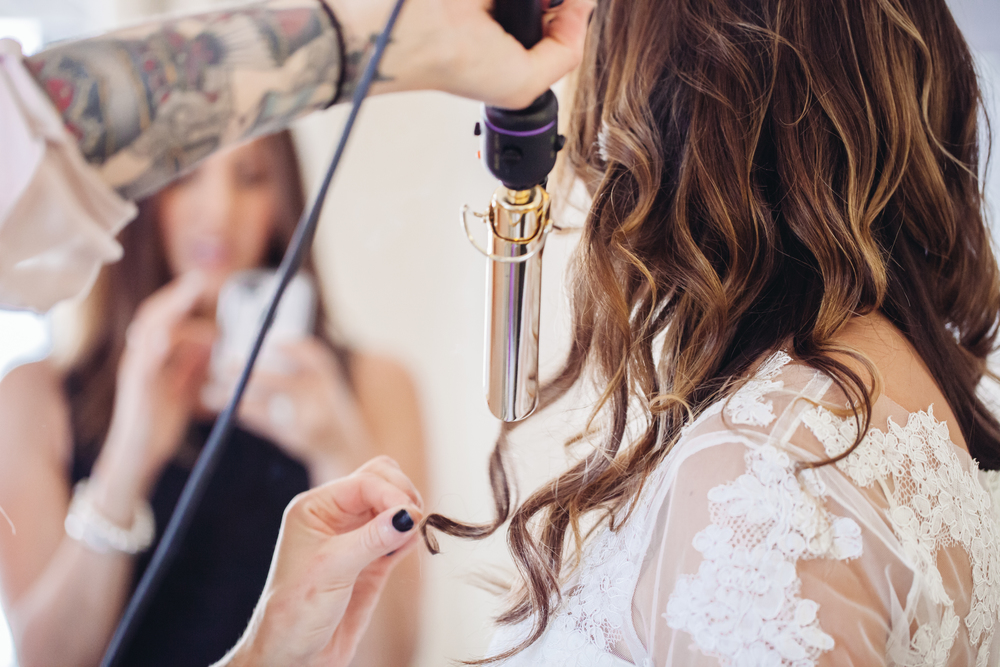 bride doing hair and make up