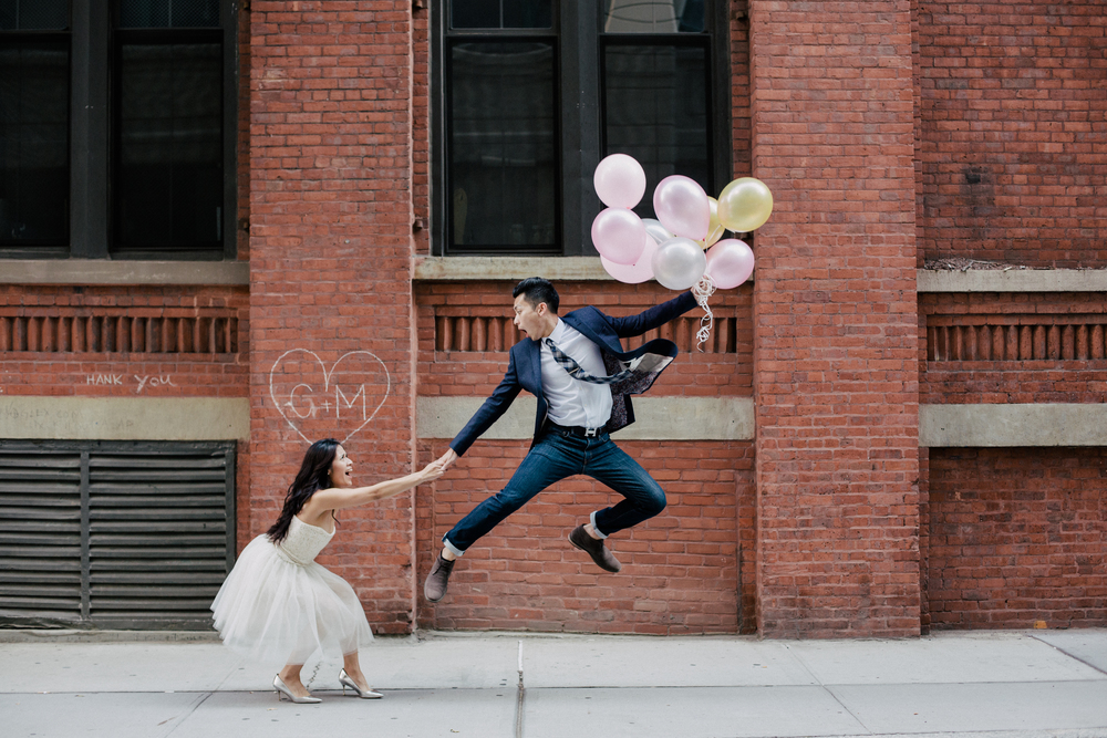 fun jumping engagement photo with balloons