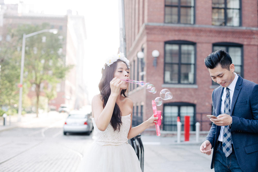 couple blowing bubbles engagement photography