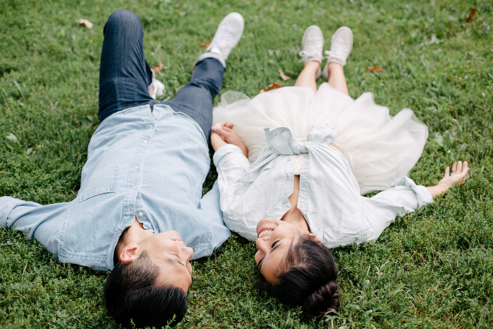 couple laying in the grass engagement session