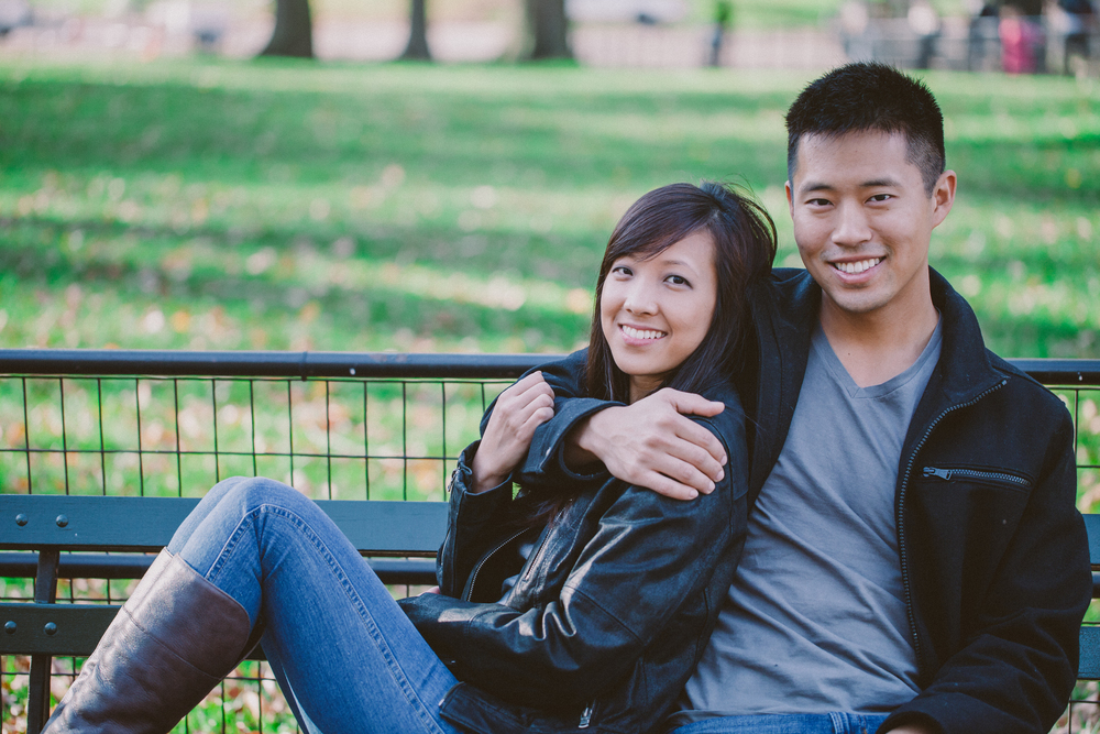 couple on bench nyc engaged photos