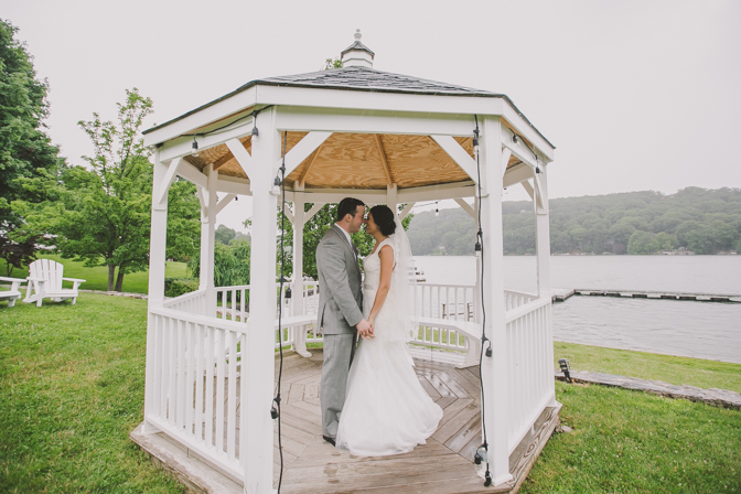 bride and groom in private gazebo