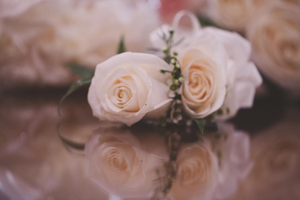 beautiful rose wedding boutonniere