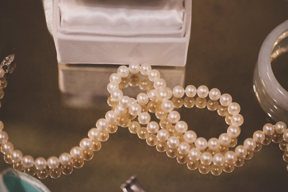 shiny pearl necklace reflection photography
