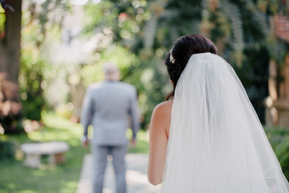 bride seeing her groom for the first time from behind