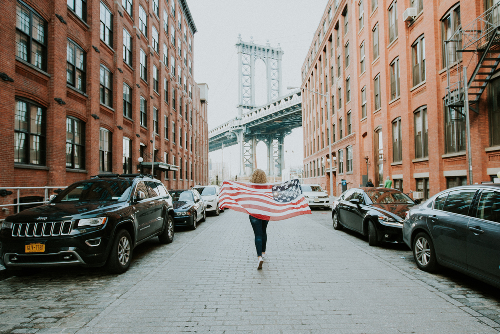 girl running with American flag