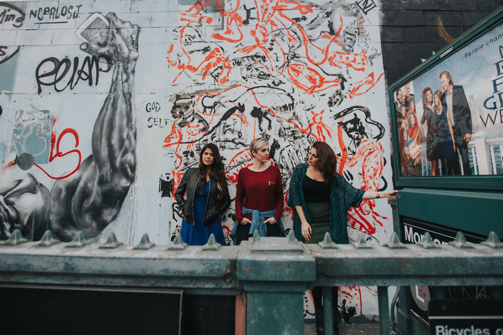 nyc models in front of graffiti wall
