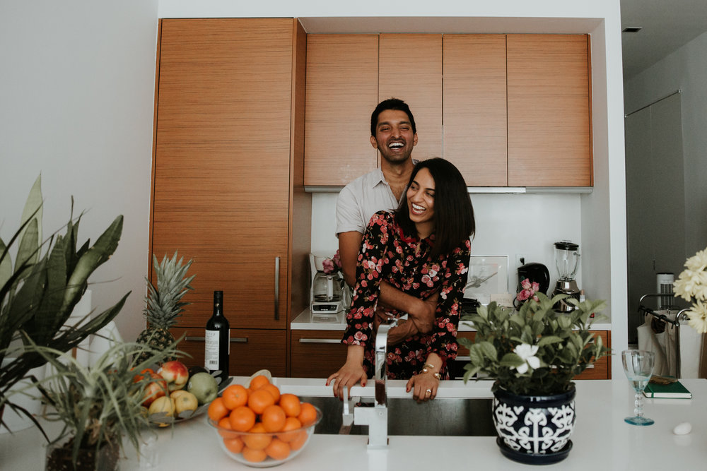 laughing couple in kitchen
