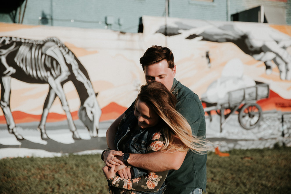 couple hugging engagement shoot