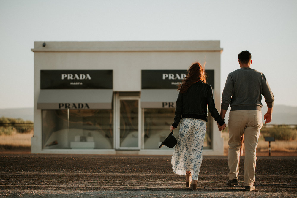 couple in front of marfa texas