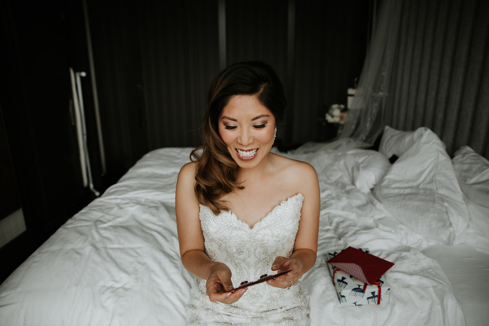 bride reading note on wedding day