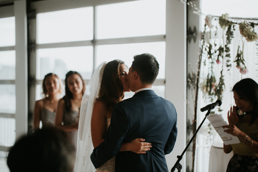 sunset terrace wedding kiss
