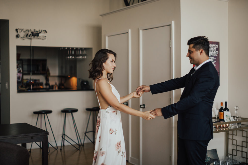 dancing in apartment nyc engagement