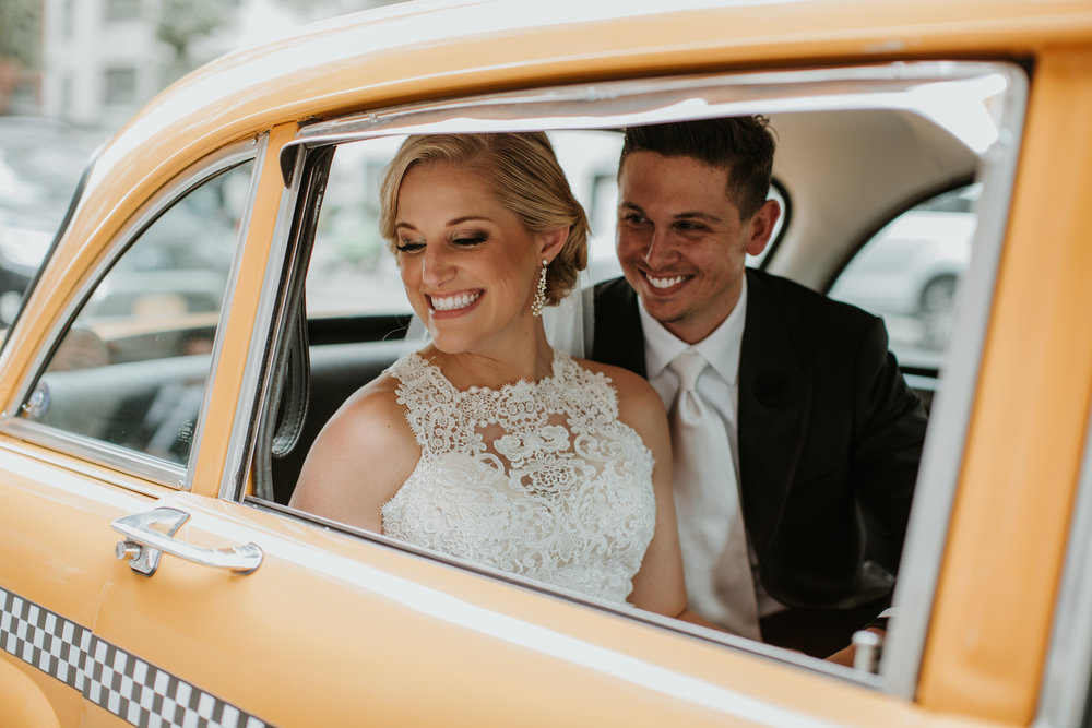 couple with nyc vintage taxi