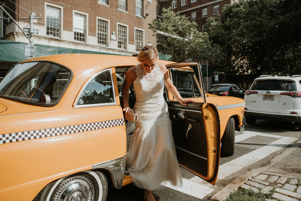bride getting out of nyc taxi