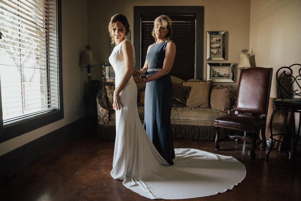 bride-putting-on-dress.jpg