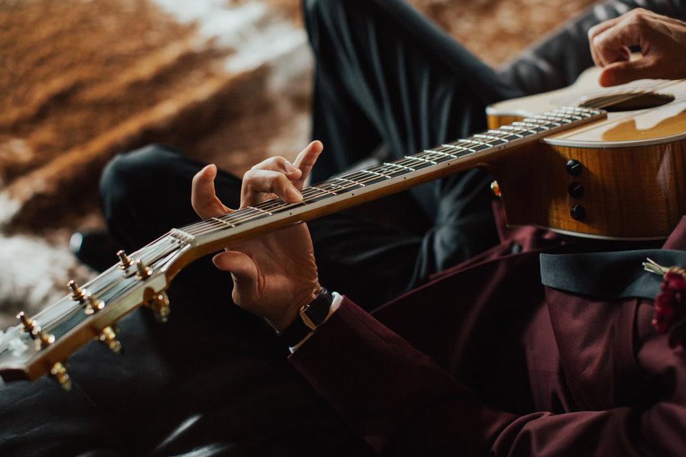 groom playing guitar