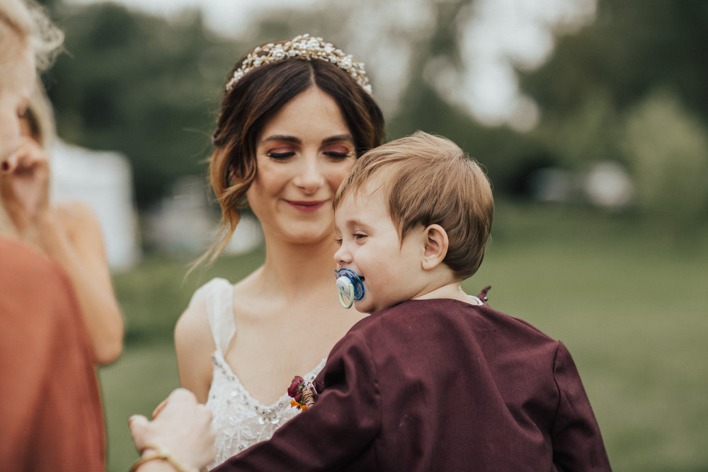 mom and child on wedding day