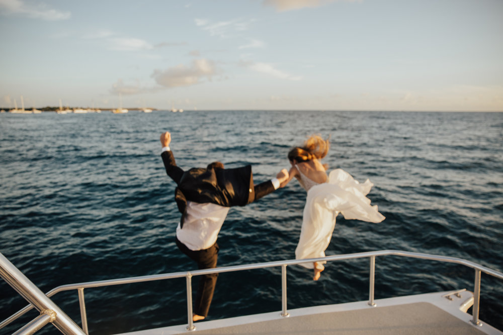 bride and groom cliff jumping