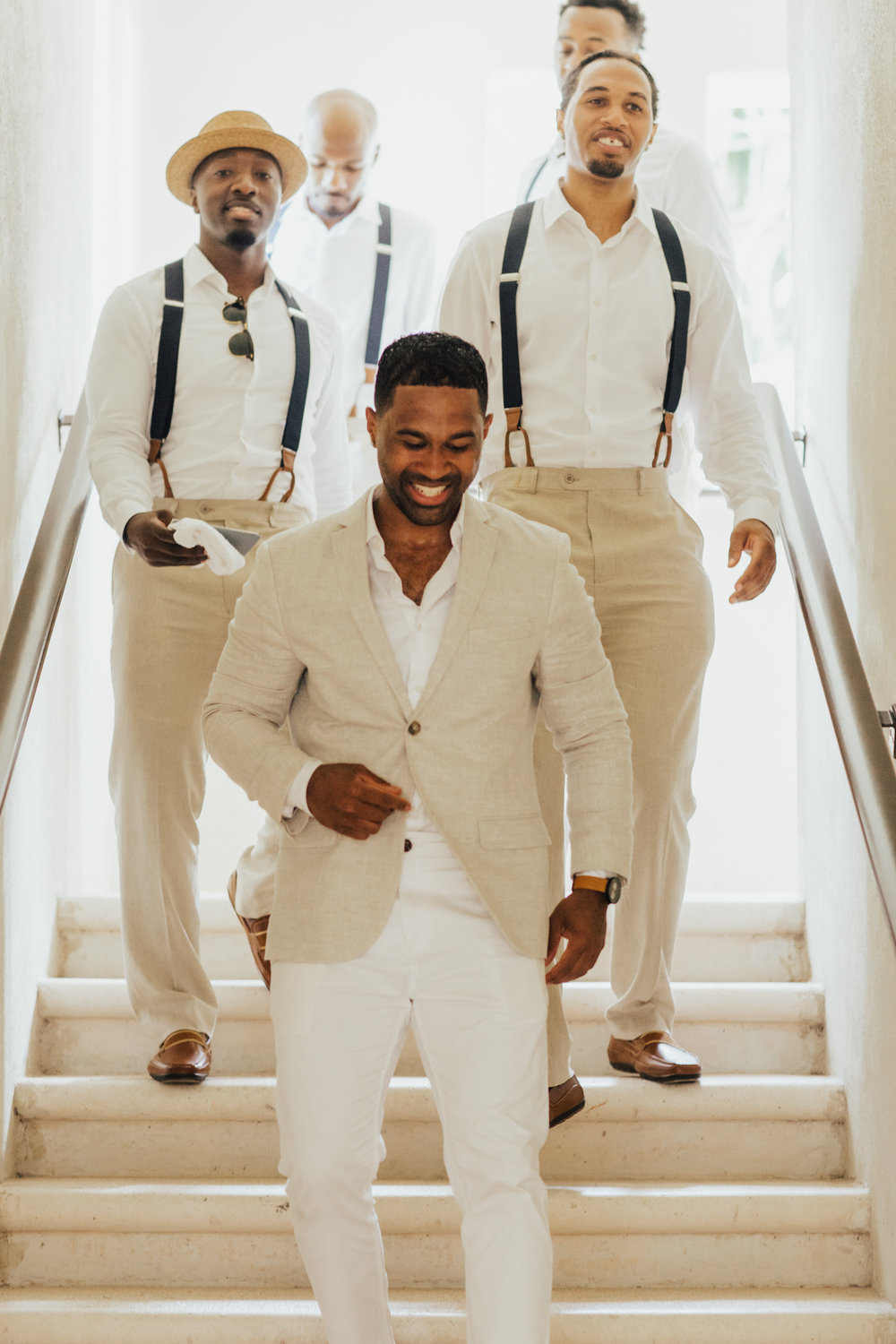 all white suits groomsmen