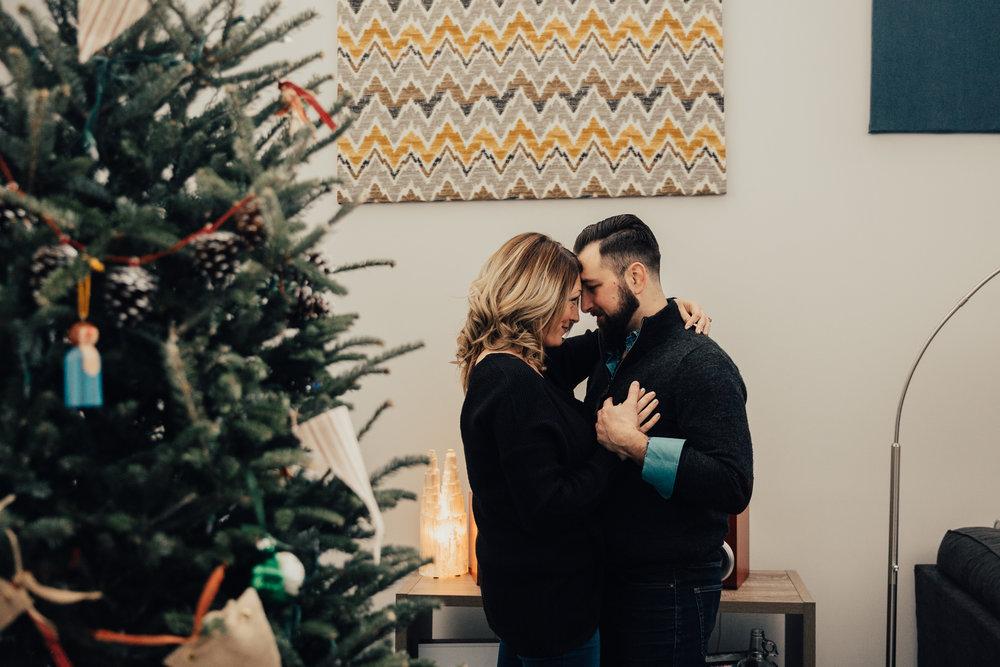 couple dancing with christmas tree