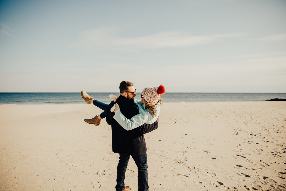 guy lifting girl engagement pose
