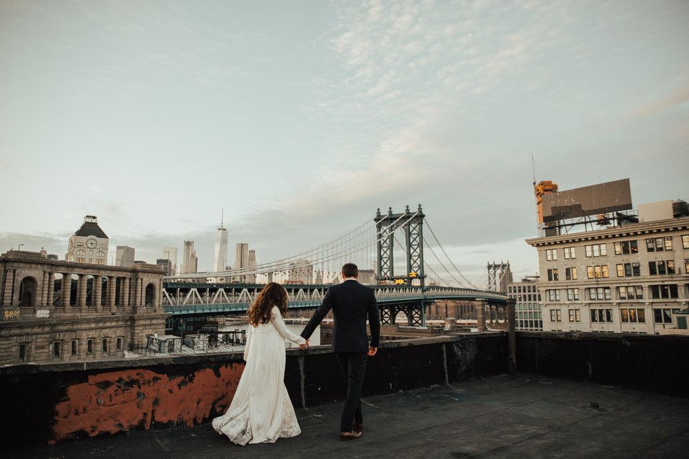 bride and groom on nyc rooftop