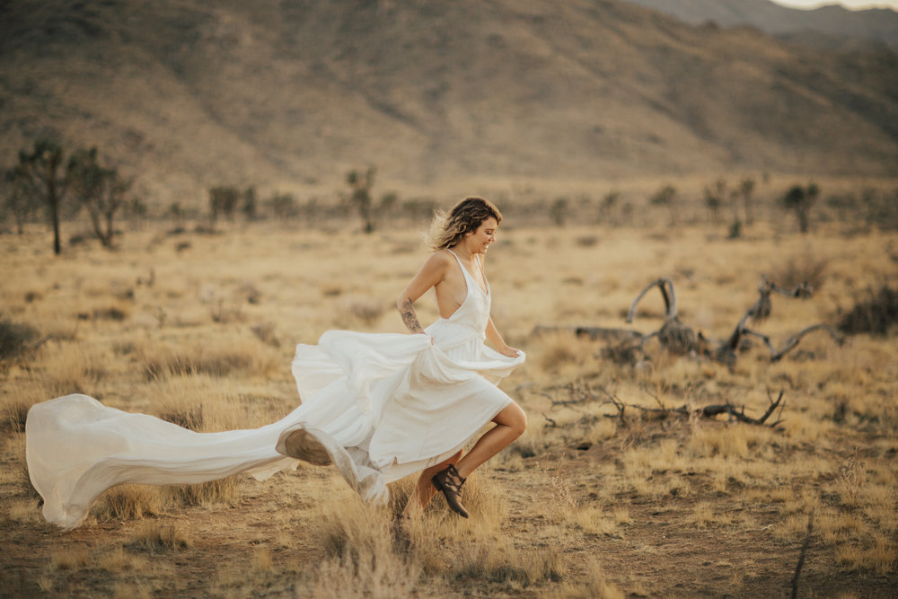 bride running through desert