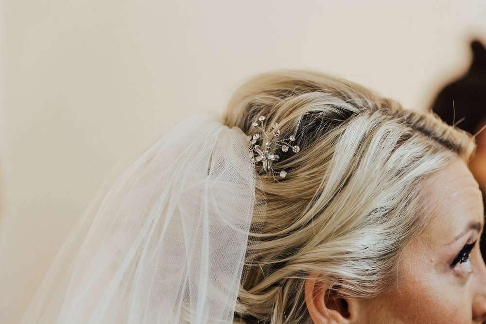 modern bridal hair with veil