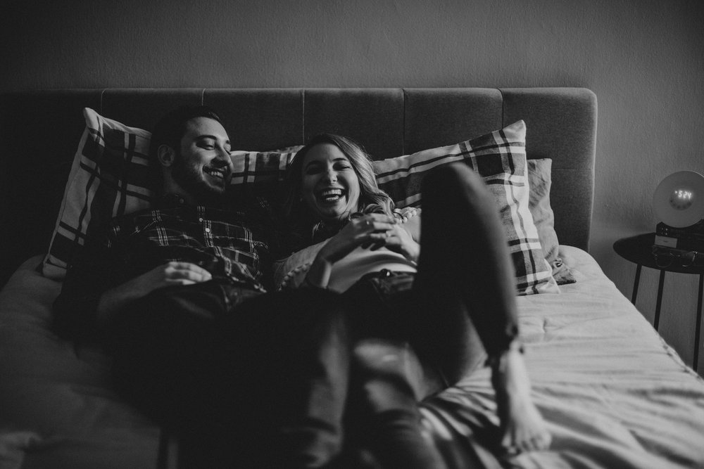 fun in bed engagement shoot photos