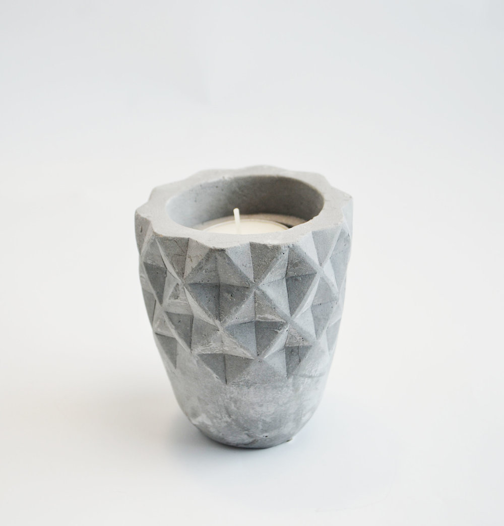 embossed stone votive   Quantity: 4  Price: $4.50