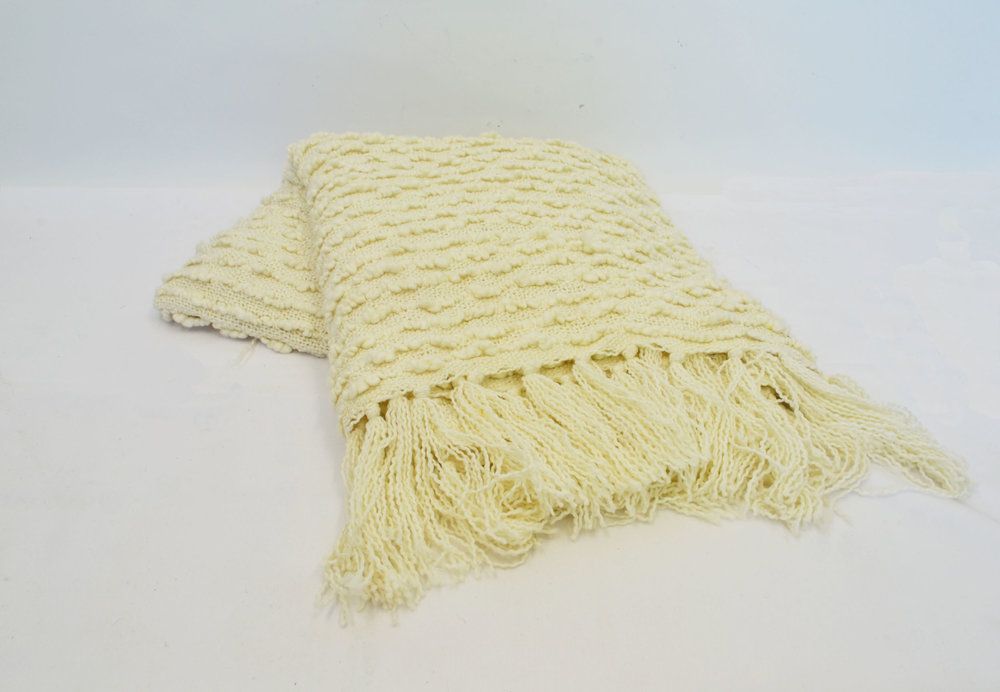 cream throw blanket   Quantity: 1  Price: $5.50