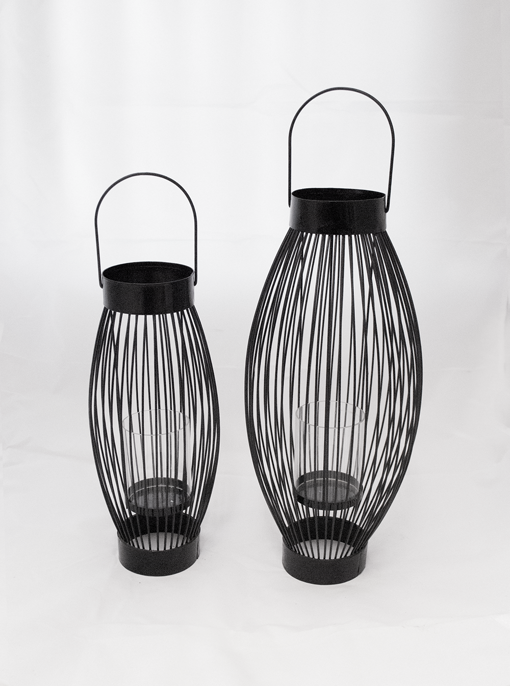 Page Lantern  Black metal + glass cylinder  Quantity: (Short. 3 ) - (tall. 3)  Price: $10.00 - $15.00