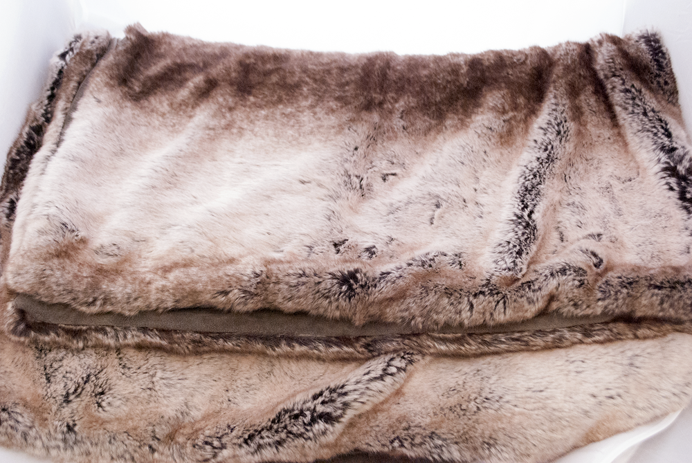 brown plush throw   Quantity: 1  Price: $5.50