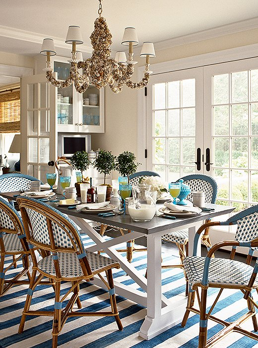 Coastal Dining Room with Shell Chandelier, Striped Rug and Paris Bistro Chairs