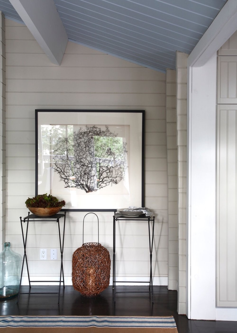 Oversize Sea Fan Wall Decor, striped rug, and blue ceiling