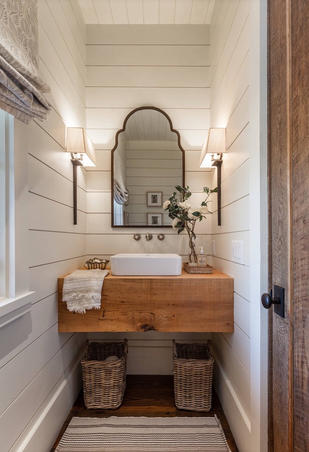 Shiplap Powder Bathroom with Rustic vanity, vessel sink, and shiplap walls