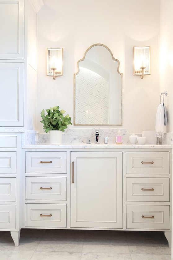 Old Sea Groves Home Bathroom with Arched Mirrors