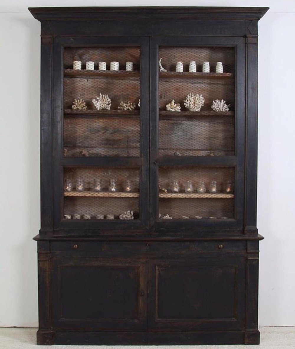Painted black display hutch with natural wood interior