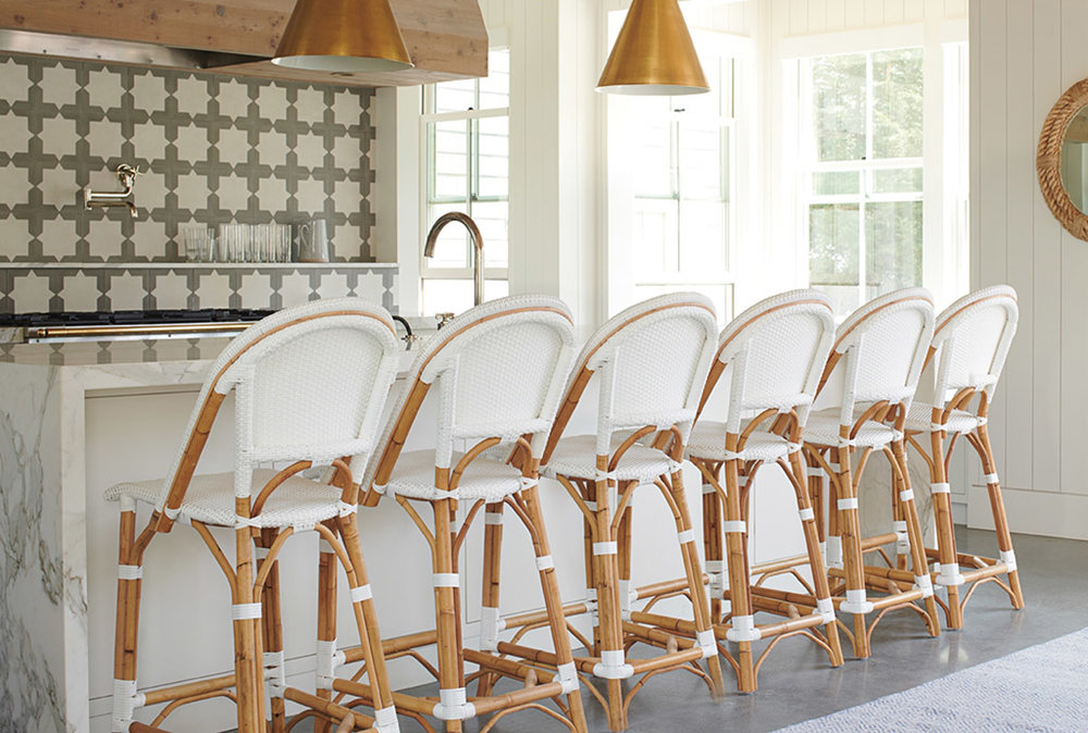 Coastal Kitchen with White and Rattan Barstools