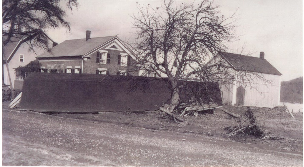 More damage from the flood of 1927. The farmhouse is narrowly spared!