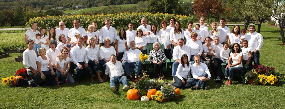 In this 2010 family portrait, Gloria Conant is surrounded by her children, grandchildren, and great-grandchildren at a family gathering.