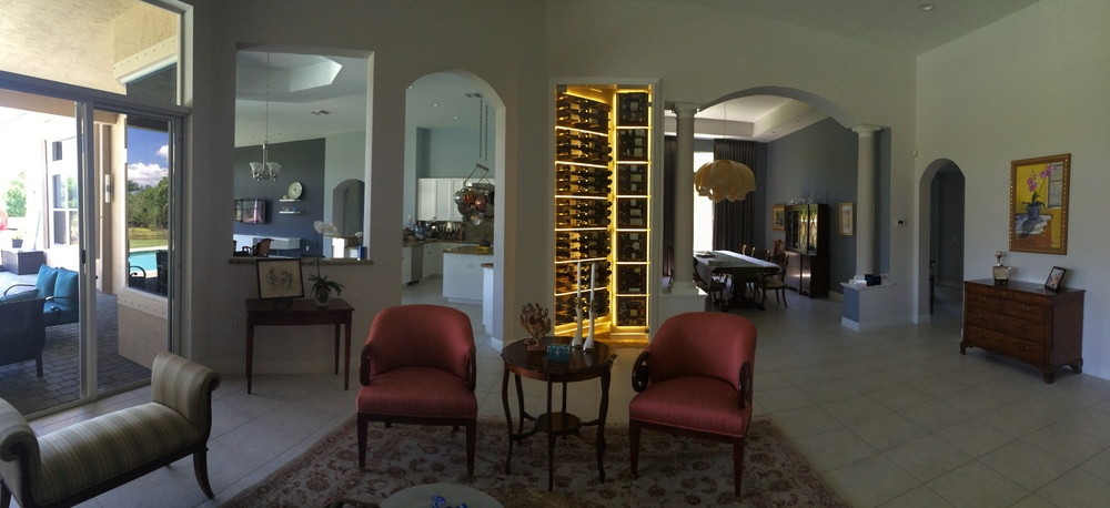 A custom 75 cubic foot wine cellar stretching over 10 feet high. Built with custom racking units that illuminate 360 degrees around each panel. Followed by a full view glass door, and a hand-laid wine cork floor.