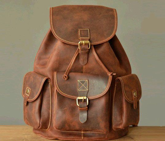 brown leather vintage backpack, lots of pockets and super cool looking in a broken in kind of way
