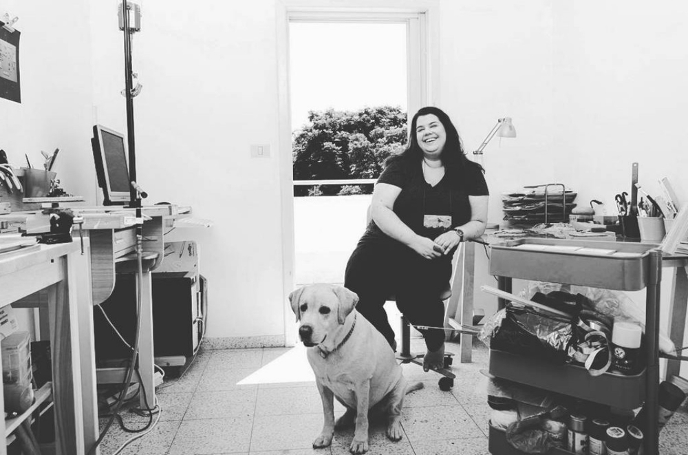 Jewelry designer Noy Alon necklace, from telaviv, www.noyalon.com, in her studio with her dog