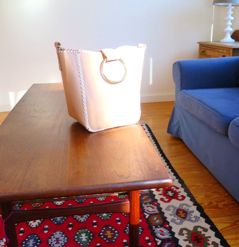 Mary Savel Nude Knocker Tote on Coffee Table in Sunshine