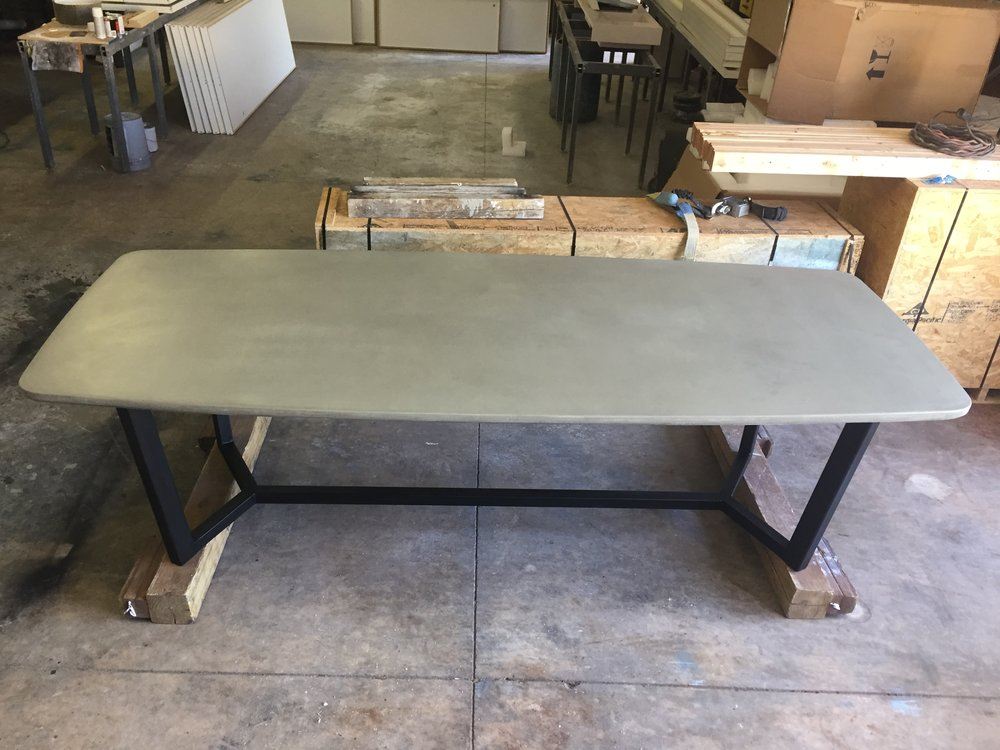 CONCRETE DINING TABLE ON STEEL BASE