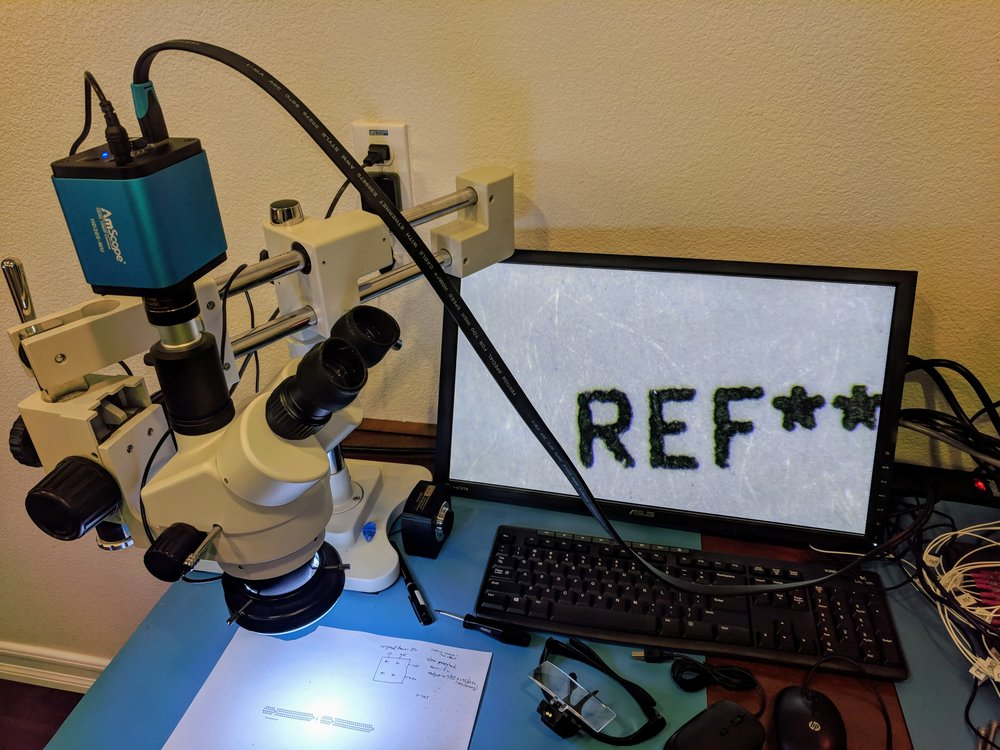 "ToupCam mounted on an AmScope inspection microscope, showing the HDMI output. Yes, that's a mouse cursor in the top part of the ""E""."