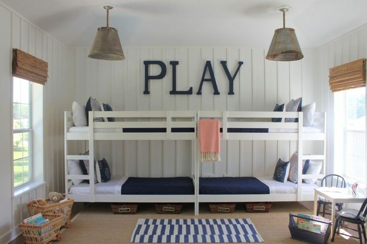 Two Ikea Bunkbeds have been placed end to end to create this great look and take up very little floor space while maximizing the space for sleeping four.